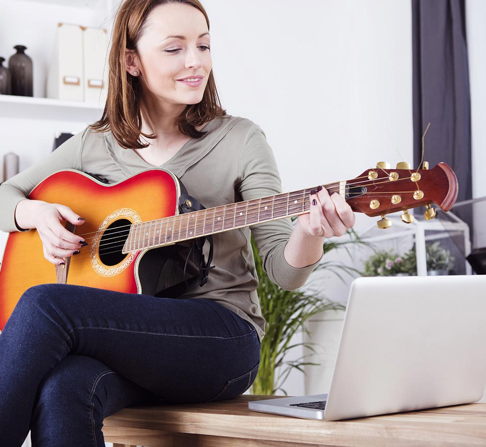 A student learning guitar on Thinkific and enjoying the student experience