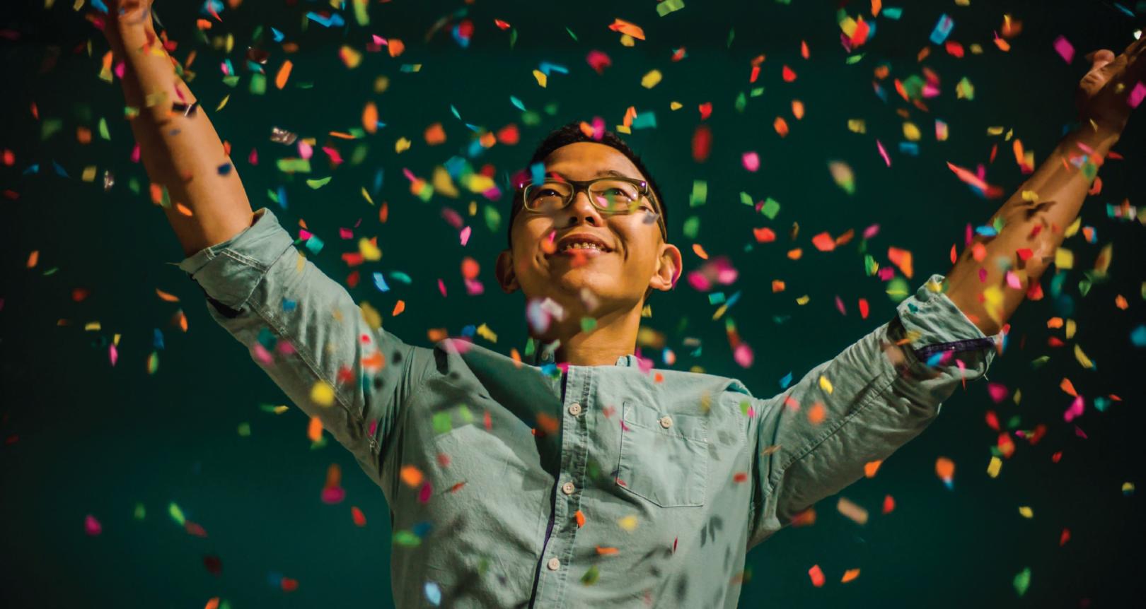 Image showcasing a man celebrating his achievements