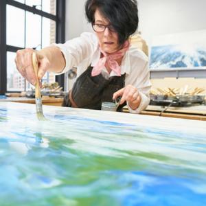 Alicia Tormey painting in her studio
