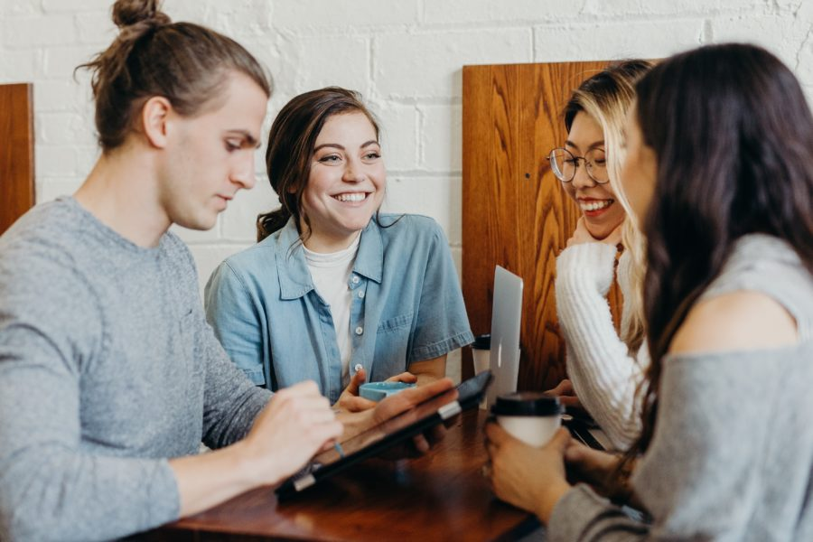 Group members enjoying eachother's company in a coffee shop