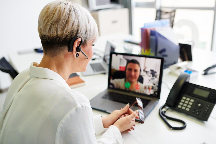 Woman Having Video Call At Table