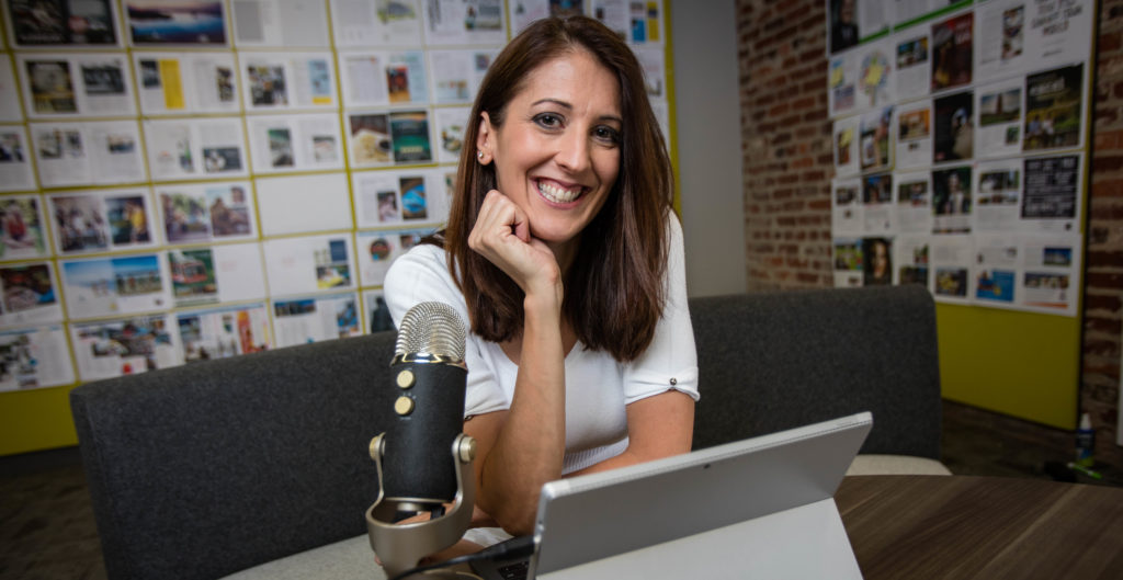 Photo of Laura Rogers iWMentor with microphone and tablet